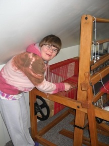 working on the loom in the attic